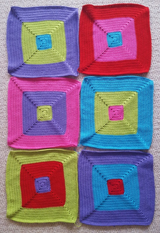 If you like bright bold colour blocking then this is the blanket for you.  Click to watch this come together from vibrant crochet squares.
