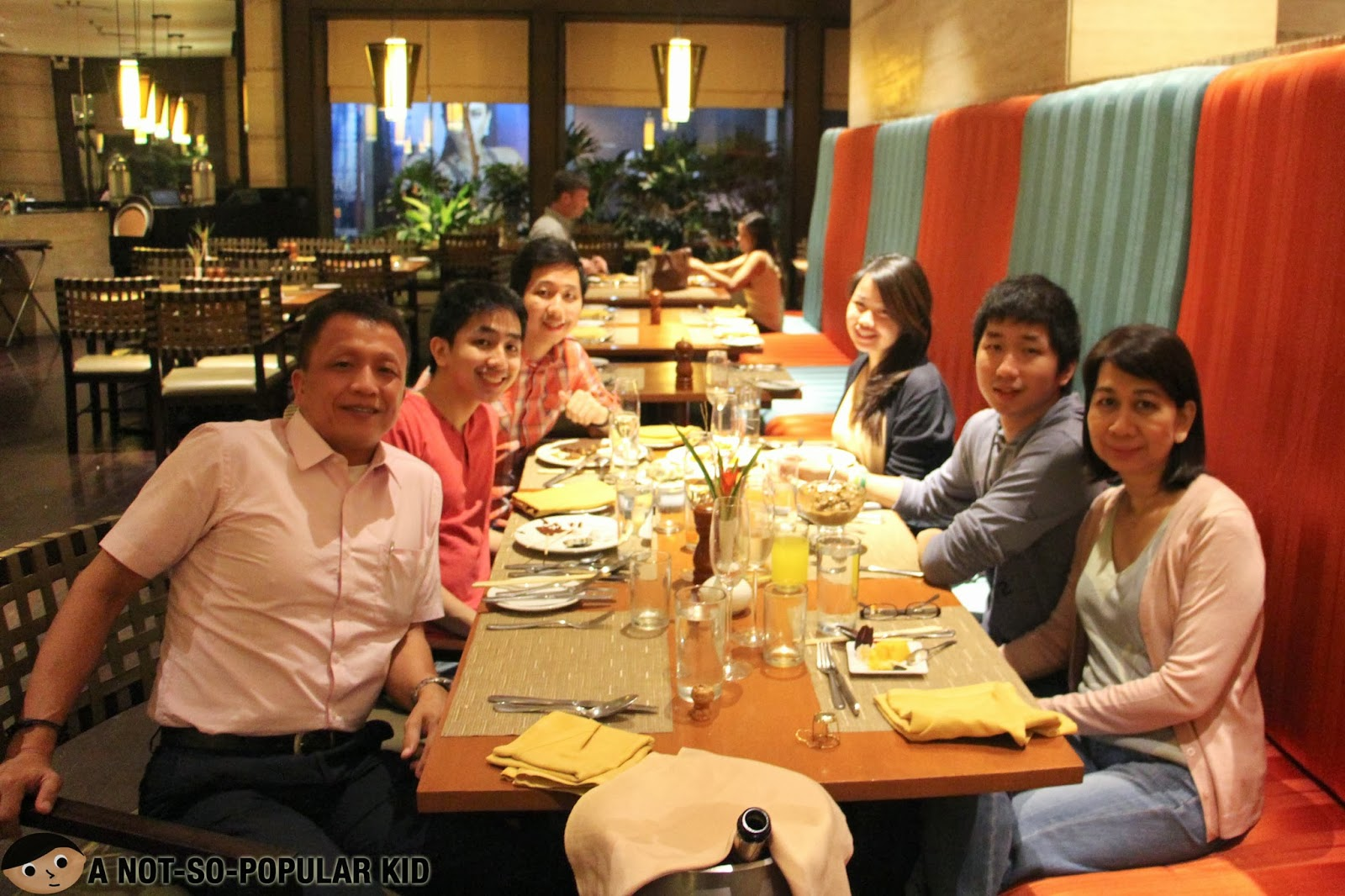 A Not-So-Popular Kid celebrating graduation with the family in Basix of Dusit Thani