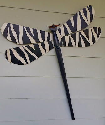 table leg fan blade dragonfly with zebra black and white wings