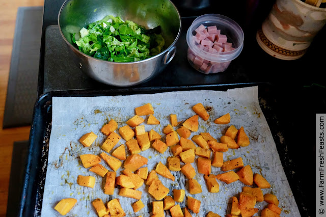 ingredients for making this recipe: roasted butternut squash cubes, a bowl of shredded brussels sprouts, and a bowl of ham cubes