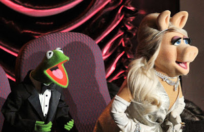 Miss Piggy with her ex Kermit at the 2012 Academy Awards. Photo: Getty Images