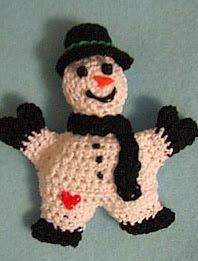 http://www.ravelry.com/patterns/library/snowman-pin-2