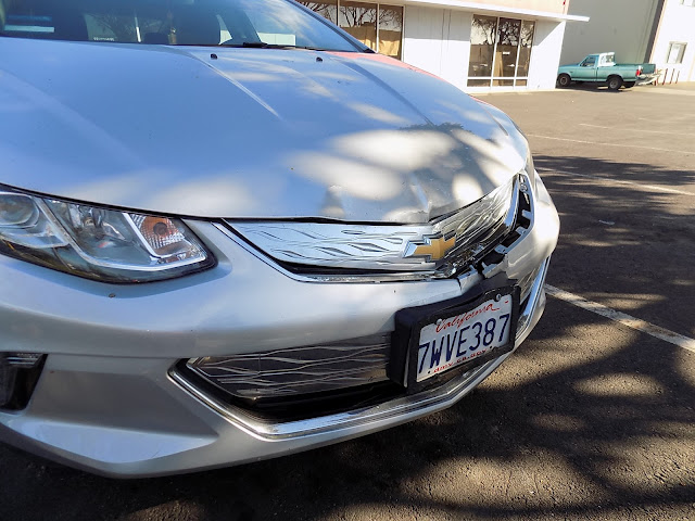 Front end damage on 2017 Chevy Volt before collision repairs at Almost Everything Auto Body.
