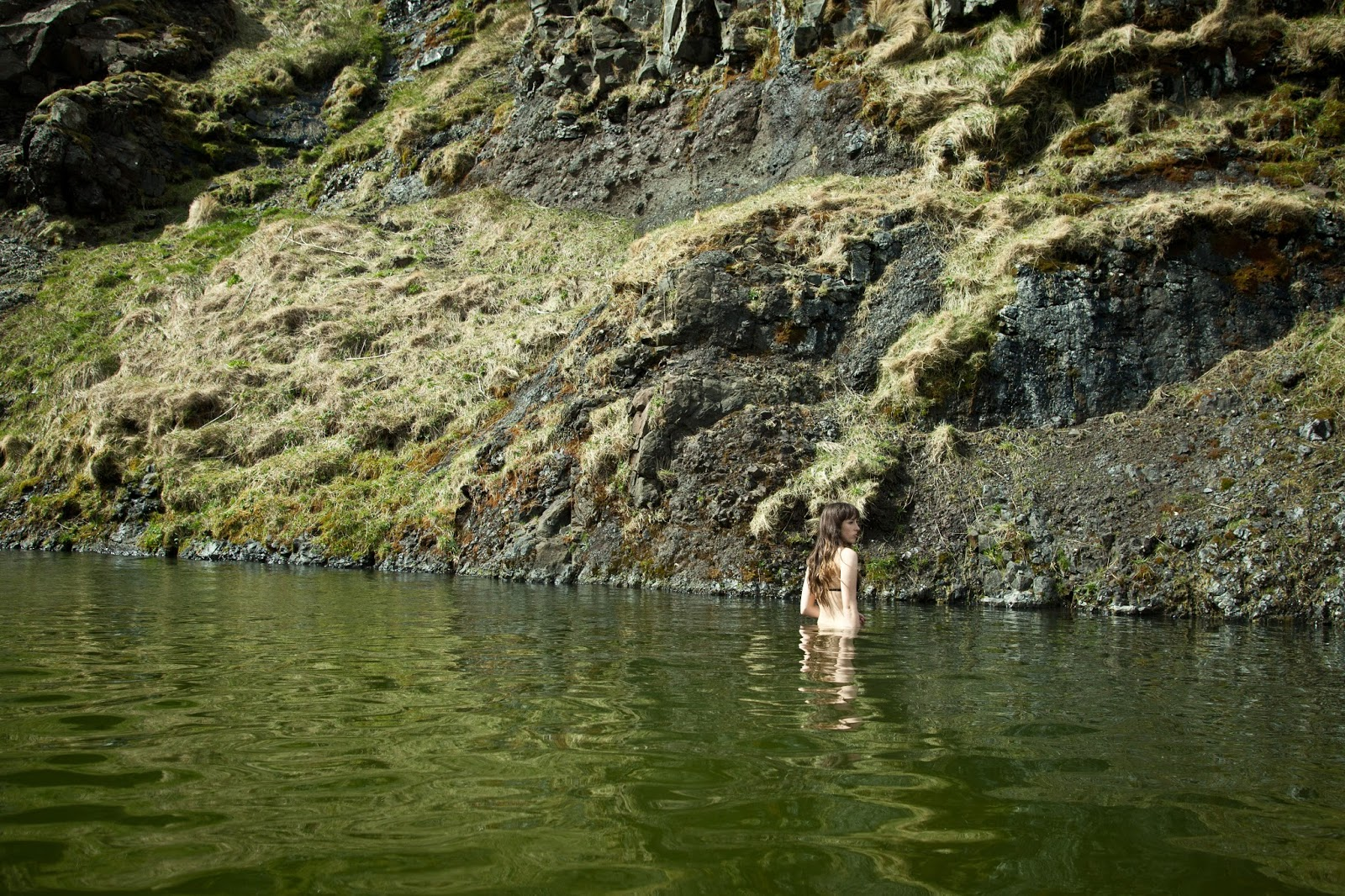 Swimming at Seljavallalaug Hot Pool Iceland
