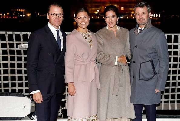 Crown Princess Victoria wore MaxMara pink Lilia cashmere wrap coat. Crown Princess Mary wore a Ralph Lauren dress