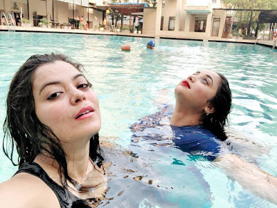Rani Chatterjee and Nidhi Jha in swimming pool.