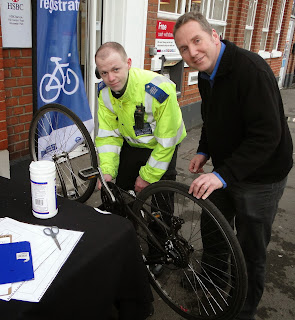 Simon Densley getting his bike marked and registered by police at Worcester Park