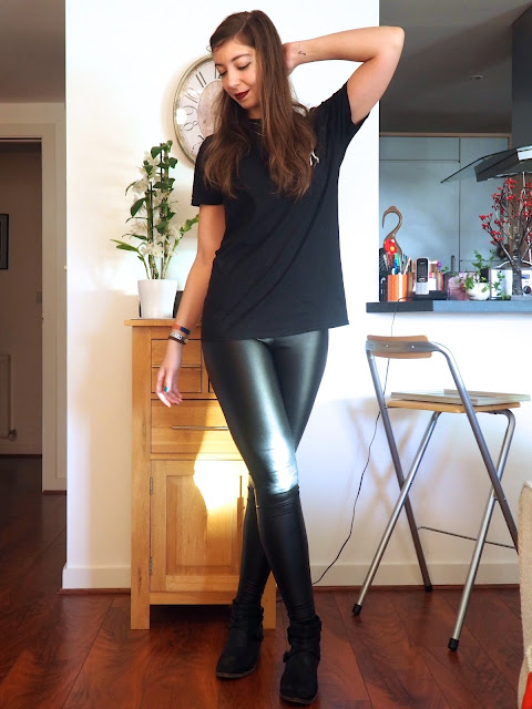 Leather Look | outfit of black Deaf Havana t-shirt with skull print, faux black leather leggings, and black high heeled ankle boots