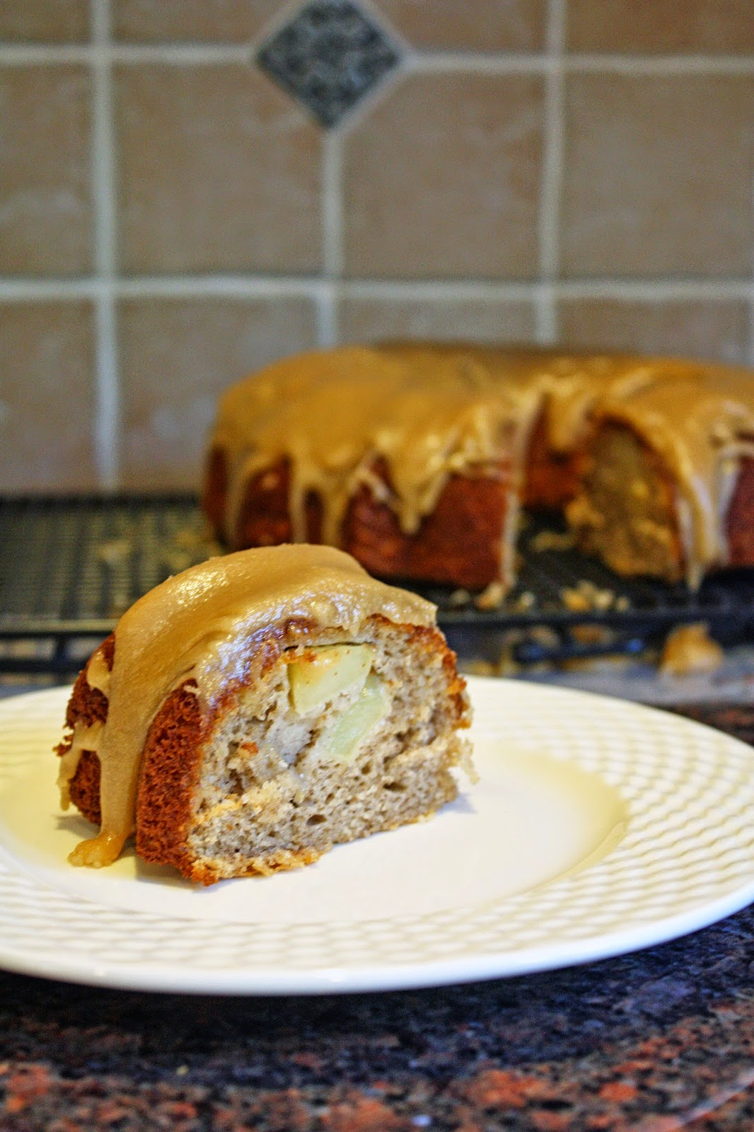Vegan apple Bundt cake with brown sugar glaze.