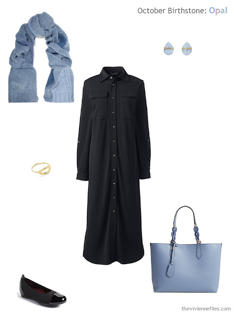 black shirtdress with blue opal earrings and blue accessories
