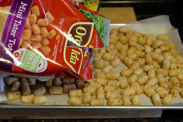 A picture of the frozen tater tots being poured onto a baking sheet.