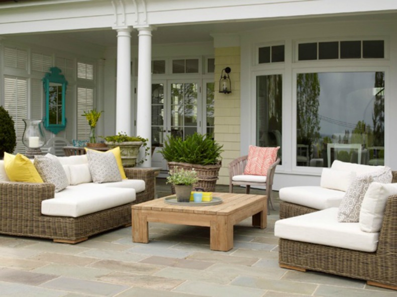 Coastal outdoor living room with wicker sofas and chairs