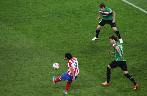 Atlético Madrid striker Radamel Falcao scores against Athletic Bilbao in the Europa League final