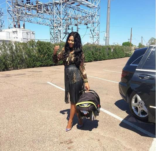 New mum Lillian Esoro steps out with her baby