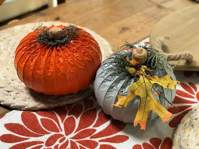 Orange and grey painted dryer hose pumpkins