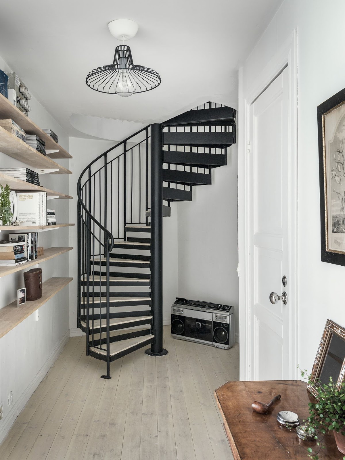 duplex apartment with black metal staircase