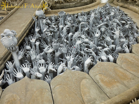 Hands and more hands in Wat Rong Khun, Chiang Rai, North Thailand
