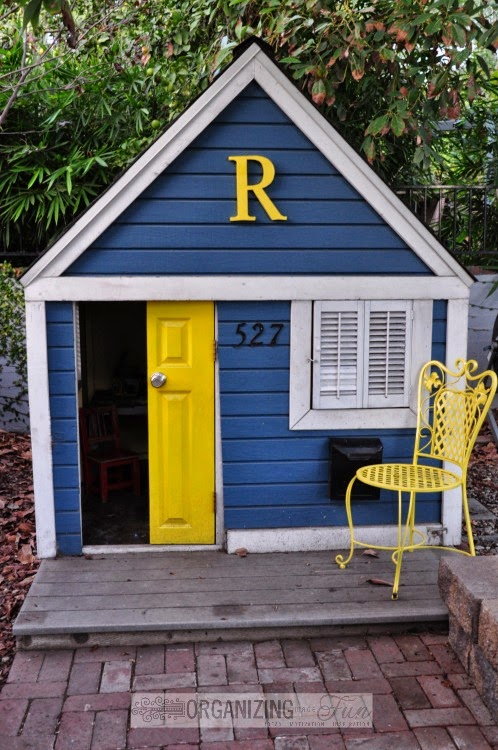 Adorabe kids' playhouse painted blue and yellow with white trim :: OrganizingMadeFun.com