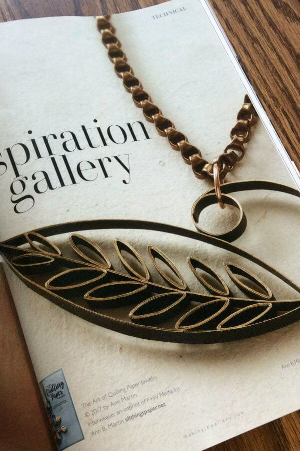 black and gold quilled paper Solitary Leaf Pendant on chain from The Art of Quilling Paper Jewelry book, pictured in Making Jewellery magazine