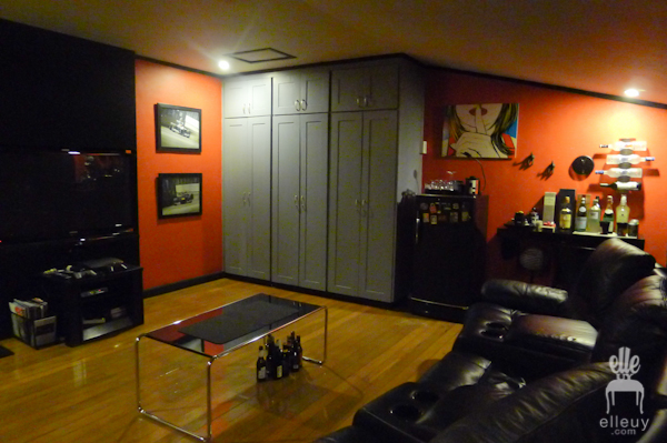 red wall tv room man cave