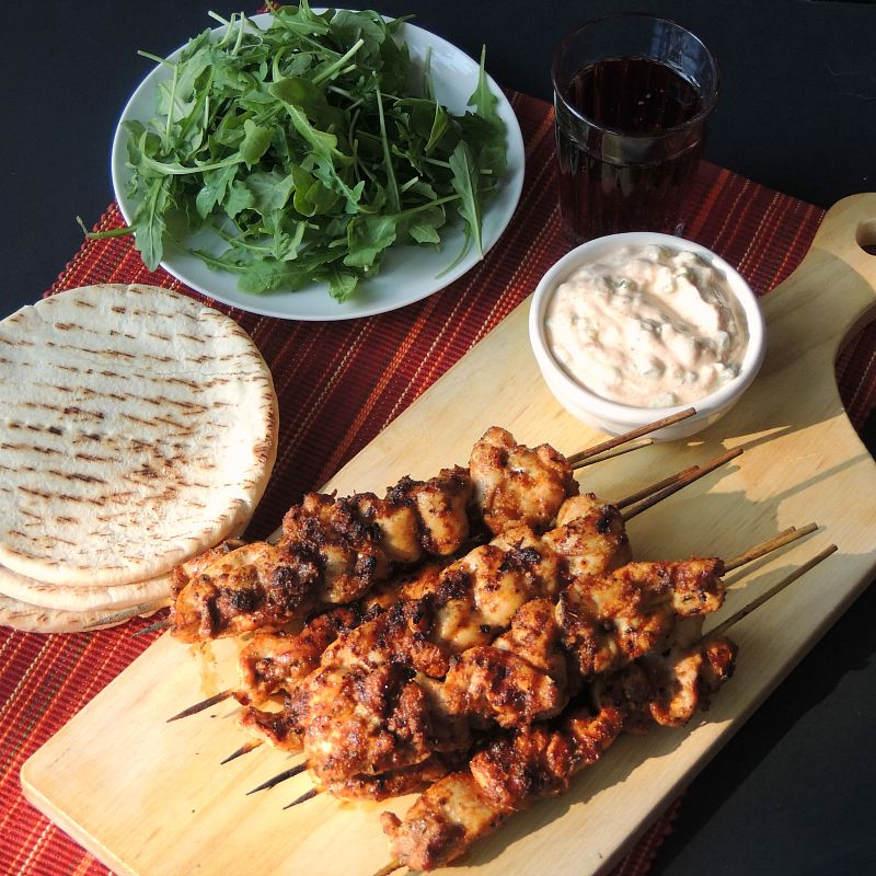 "This Harissa Spiced Chicken Kabobs recipe brings just enough heat to make your tastebuds sit up and say ""Howdy!"". For a low carb meal use keto pita or flatbread, or just gobble them up in a lettuce wrap. #chicken #middleeastern #african #harissa #grilling #grilled #kabobs #kebabs #recipe #keto #lowcarb 
