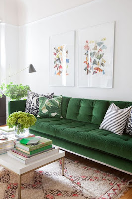 green velvet sofa, white walls
