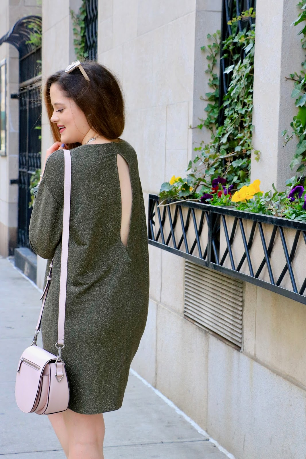 Fashion blogger Kathleen Harper wearing a green open-back dress