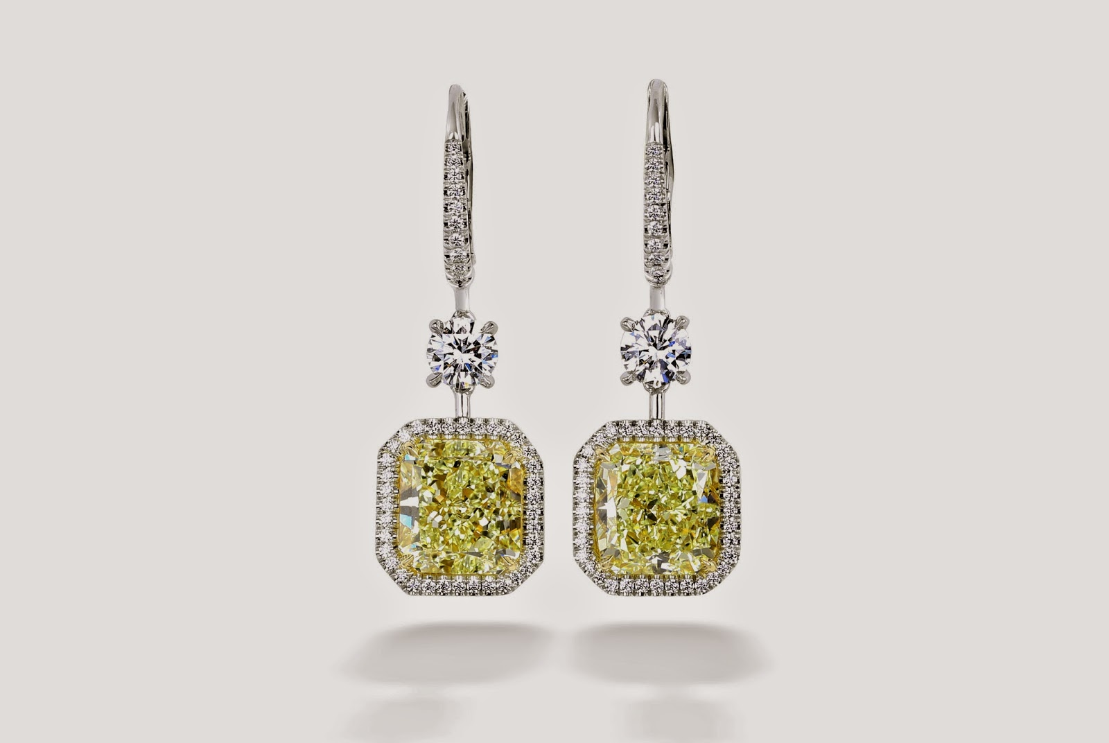 Center Of My Universe Fancy Yellow Diamond Earrings By Premier Gem Set In 18k White Gold 10 05 Ctw