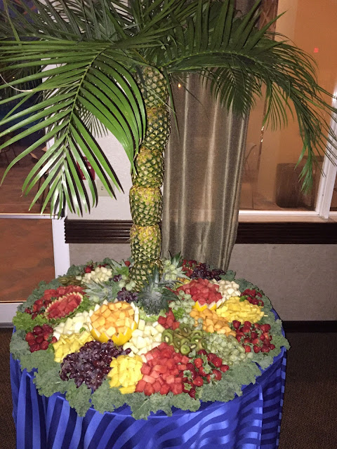 fruit display, palm trees, pineapples