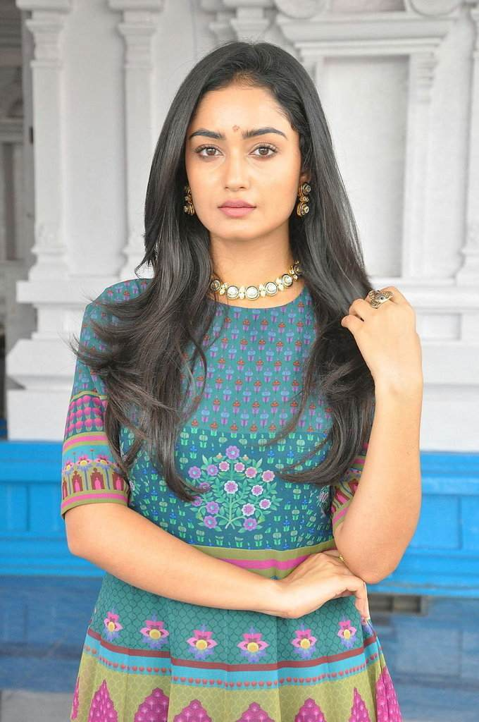 Glamorous Bengali Girl Tridha Choudhury Long Hair Photos In Blue Dress
