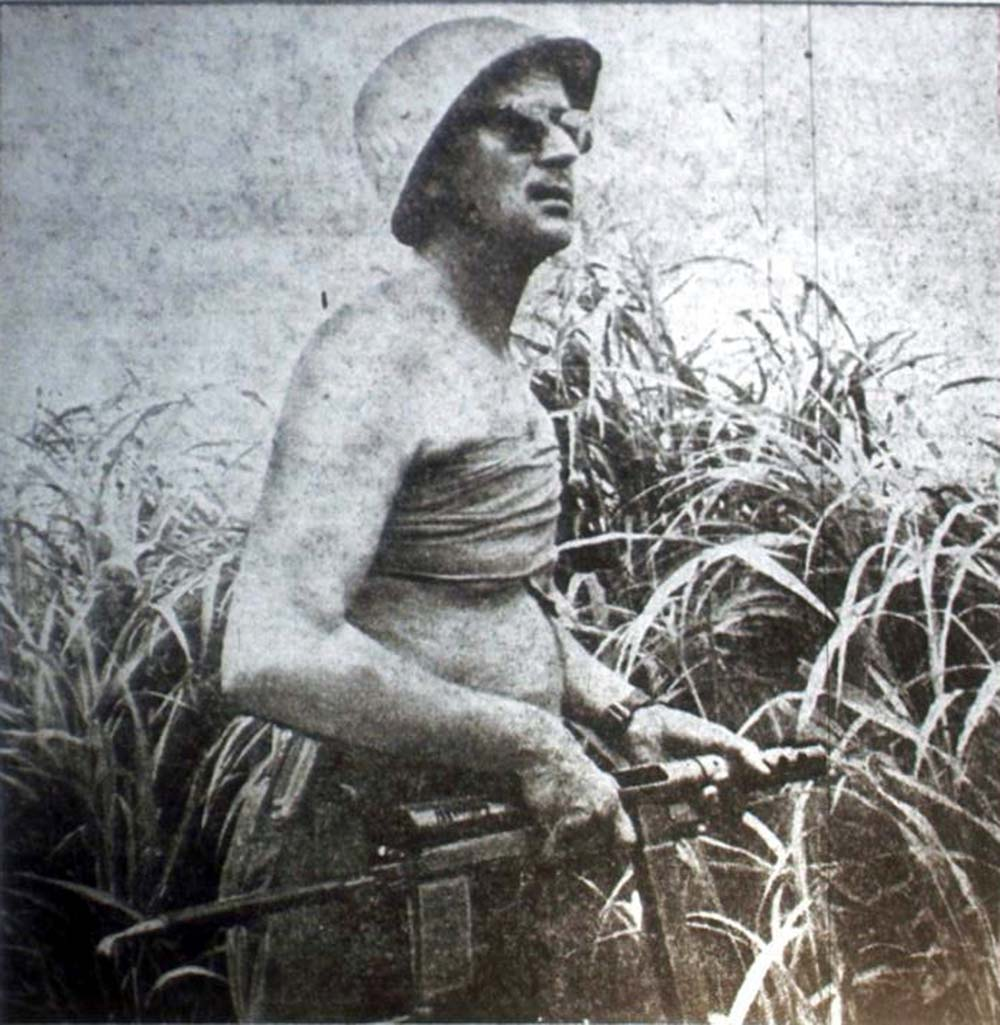 Major Eric Bonde was lightly wounded in the ambush. After given first aid he returned to the fight against the invisible enemy in the jungle bush.