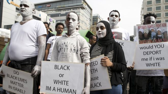 Israel suspends plan to send African migrants to West