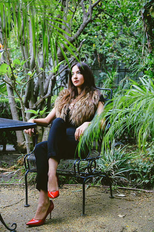 black jumpsuit red heels in the garden
