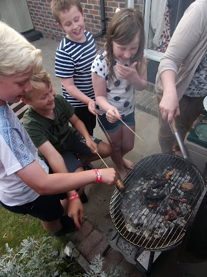 laughing children barbecuing things