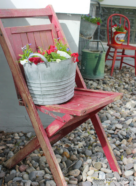junk planter, garden junk, flowers, annuals, metal bucket, state fair chair, upcycled, http://bec4-beyondthepicketfence.blogspot.com/2016/05/junk-planters.html