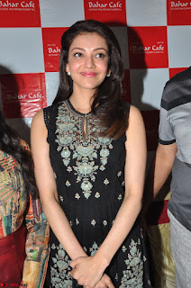 Kajal Aggarwal in lovely Black Sleeveless Anarlaki Dress in Hyderabad at Launch of Bahar Cafe at Madinaguda 045.JPG