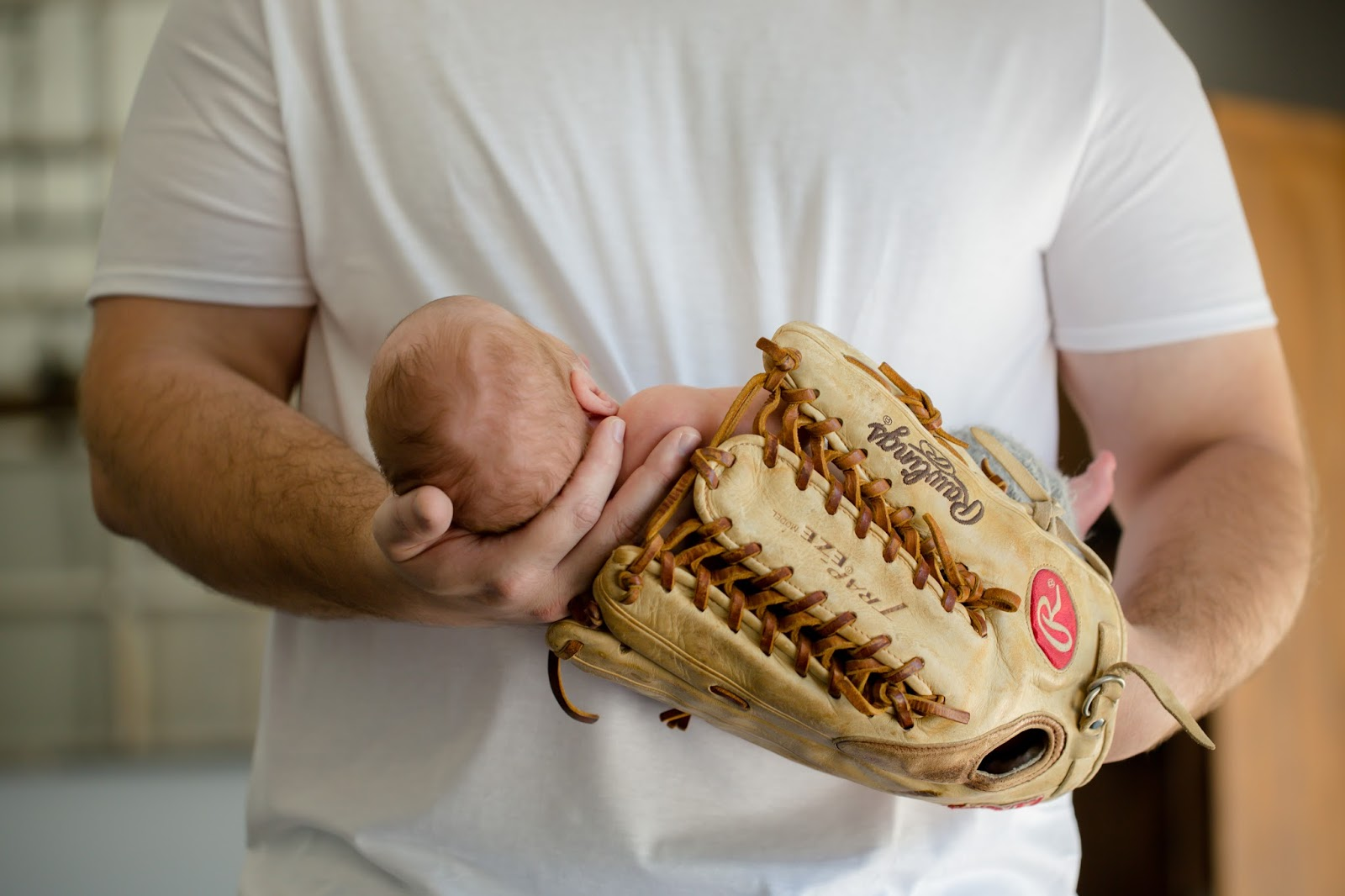 dad and son in baseball mit