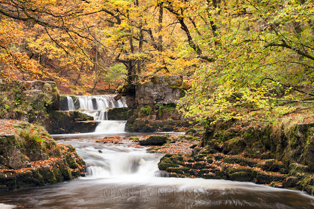 Beautiful autumn colour over Horeshoe Falls in the Brecon Beacons in Wales by Martyn Ferry Photography