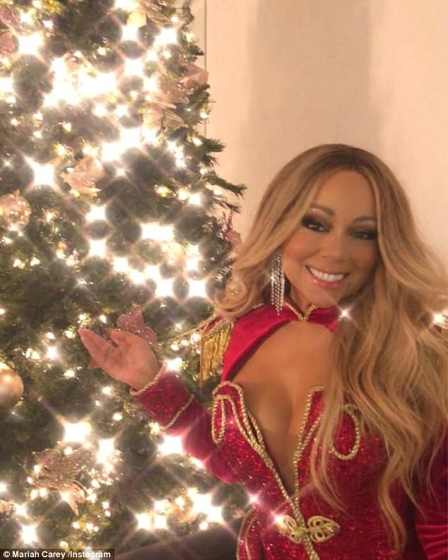 Mariah Carey sparkles in cleavage baring dress