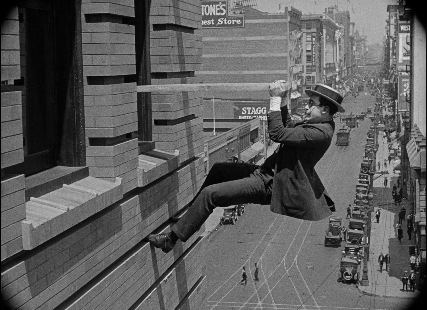 Harold Lloyd climbing building Safety Last silent movie