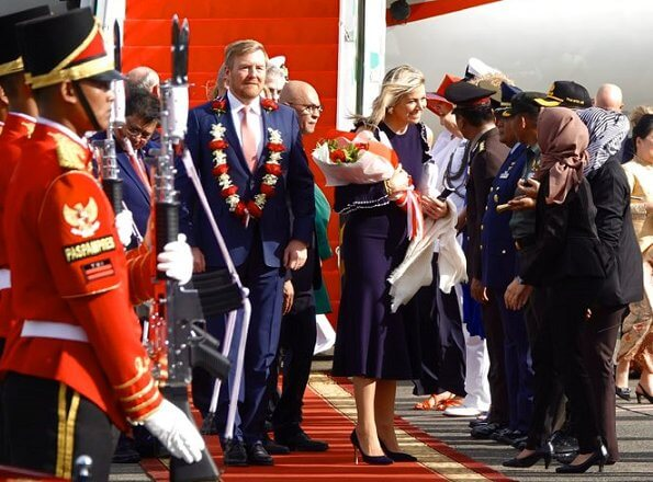 Queen Maxima wore Oscar De La Renta Cold-shoulder ruffled wool midi dress. President Joko Widodo, Kalimantan and Sumatra