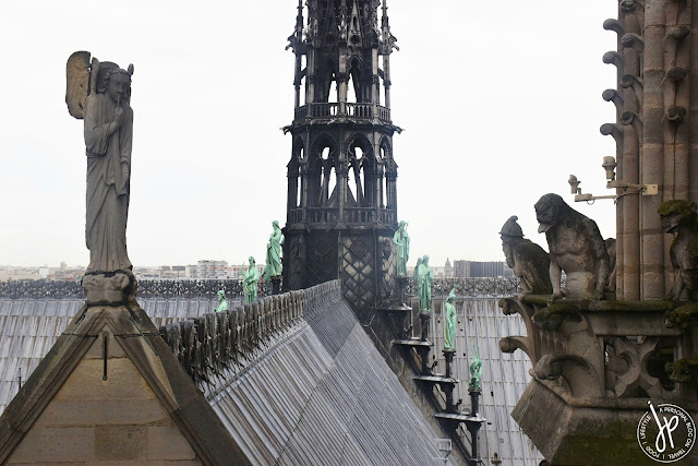 winged man and monster sculptures on gothic church