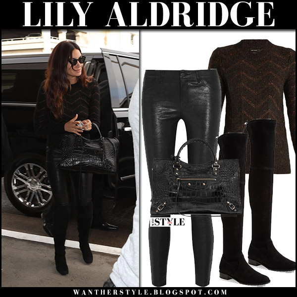 Lily Aldridge in black knit zigzag sweater, black leather pants j brand and black suede boots stuart weitzman lowland airport style october 11 2017