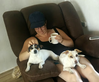 A well deserved cuppa and cuddle from the puppies