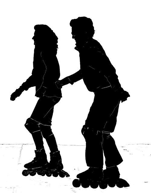 couple skating on road
