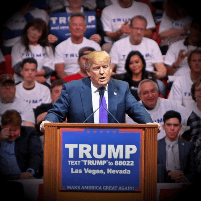 A photo of Donald Trump standing at a lectern in Las Vegas, Nevada as he speaks before a large crowd.
