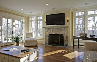 dazzling laminate floor paired with stoned fireplace plus white sofas also windows design