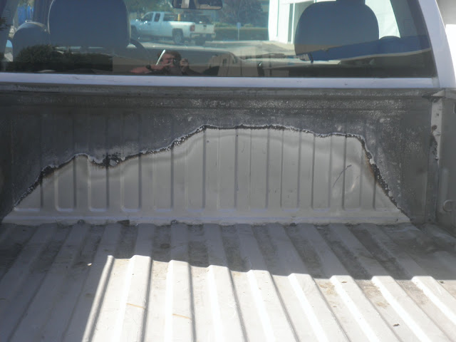 Rust inside salvaged bed before auto body repairs & paint at Almost Everything Auto Body