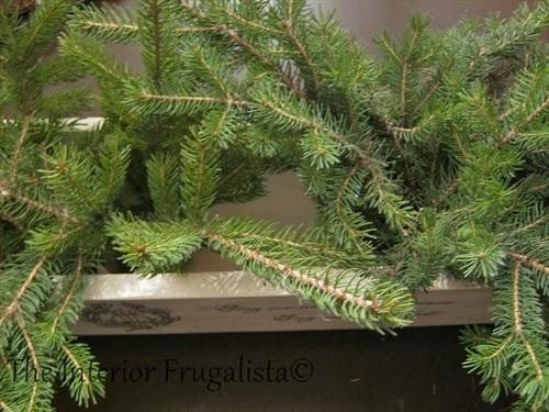 Fresh greens inside festive pallet board centerpiece