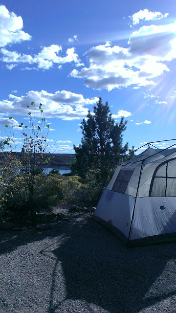 sky, clouds, tent, and trees with a view of the water in Echo Canyon Nevada